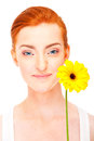 Woman with yellow flower near her face on white background big smile Stock Photography