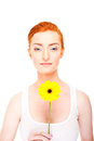 Woman with yellow flower near her face on white background big smile Royalty Free Stock Images