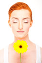 Woman with yellow flower near her face on white background big smile closed eyes Royalty Free Stock Image