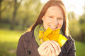 Woman with yellow leaves in autumn portrait of a young having fun a park during holding a bunch of fallen Royalty Free Stock Images