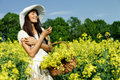 Woman in the yellow rape field young Royalty Free Stock Image