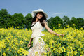 Woman in the yellow rape field young Royalty Free Stock Photos