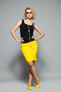Woman in a yellow skirt Royalty Free Stock Photography