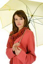 Woman with yellow umbrella Stock Photos