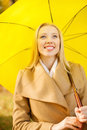 Woman with yellow umbrella in the autumn park holidays seasons travel tourism happy people concept smiling Royalty Free Stock Image