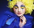 Woman with yellow wig feather Royalty Free Stock Photo