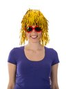 Woman with yellow wig and red sunglasses funny Royalty Free Stock Image