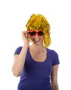 Woman with yellow wig and red sunglasses funny Stock Image