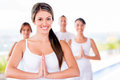 Woman in a yoga class with group of people Royalty Free Stock Images