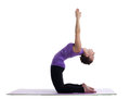 Woman yoga instructor posing on rubber mat Stock Photography