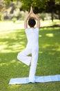 Woman yoga outdoors Stock Photo