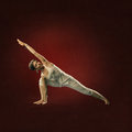 Woman in yoga position parsva kona attractive young Royalty Free Stock Photo