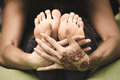Woman yoga practice closeup hands and feet