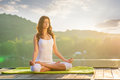 Royalty Free Stock Photo Woman Yoga - relax in nature on the lake