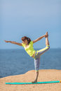 Woman yoga series outdoor on the seashore healthy resting and curl up in fetal position at sea pose Stock Photo