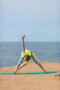 Woman yoga series outdoor on the seashore healthy resting and curl up in fetal position at sea pose Stock Images