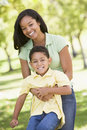 Woman and young boy outdoors embracing and smiling Royalty Free Stock Photography