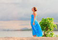 Woman young on a rocky beach Royalty Free Stock Images
