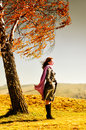 Woman young standing on an autumn hill Royalty Free Stock Photo