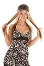 Woman zebra dress black hat hold hair a in her and playing with Stock Photos
