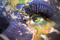 Womans face with planet Earth texture and bahamas flag inside the eye Royalty Free Stock Photo