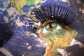 Womans face with planet Earth texture and central african republic flag inside the eye. Royalty Free Stock Photo