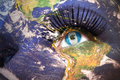 Womans face with planet Earth texture and guatemalan flag inside the eye Royalty Free Stock Photo
