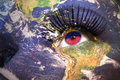 Womans face with planet Earth texture and haitian flag inside the eye Royalty Free Stock Photo