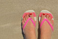 Womans feet with flip flops Royalty Free Stock Photo