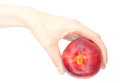 Womans hand with a fruit nectarine on white background woman s isolated Royalty Free Stock Photo