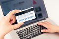 Womans hand holding a bank card over a laptop on the is written good shopping you can put any inscription on the Royalty Free Stock Image