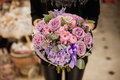 Womans hand holding a bouquet of flowers Royalty Free Stock Photo