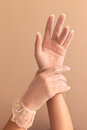 Womans hands modeling vintage lace gloves Royalty Free Stock Photo