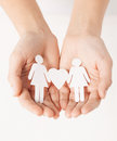Womans hands with paper women showing two woman heart shape Stock Photography