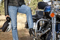 Womans leg rests on motorcycle foot rest Royalty Free Stock Photo