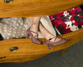 Womans legs in open dresser drawer Stock Image