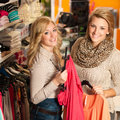 Womans shopping two girls in a clothes shop choo Royalty Free Stock Photo