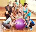 Women in aerobics class group fitness ball Stock Photos