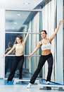 Women at aerobics exercise with fitness step board Stock Photo