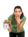 Women and alarm clock Stock Photography