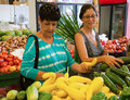 Women in American vegetable market Royalty Free Stock Photo