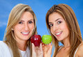 Women with apples isolated Stock Images