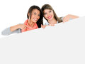 Women with a banner happy pointing at isolated over white background Stock Photography