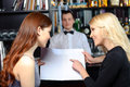 Women and barman by the counter Royalty Free Stock Photo