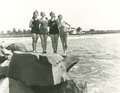 Women in bathing suits posing on rock Royalty Free Stock Photo