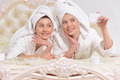 Women in  bathrobes doing selfie Royalty Free Stock Photo