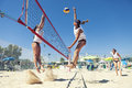 Women beach volleyball players. Attack and defense Royalty Free Stock Photo