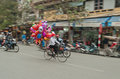Women on a bicycle with colorful balloons on the street hanoi vietnam in Stock Photo