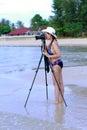 Women bikini body sexy with camera Royalty Free Stock Photo