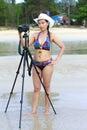 Women bikini body sexy symbol with camera Royalty Free Stock Photo